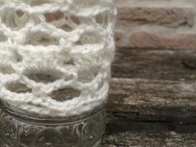 Fles haken met wit wol